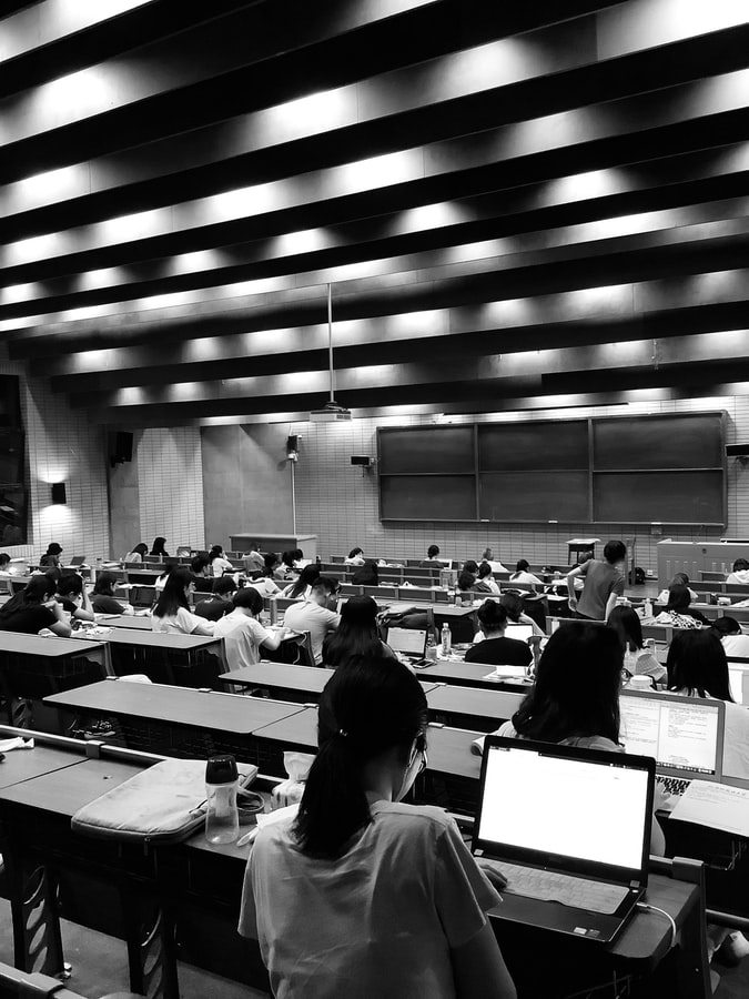 Photo of students sitting in a lecture hall.